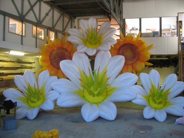 painted 3m lily and 2.5m sunflowers