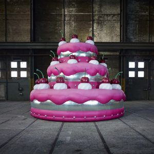 6.2m inflatable pink and silver cake in a warehouse