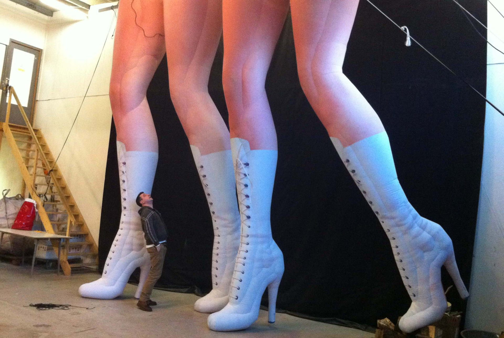 5m inflatable legs in knee-high boots Airworks Rentals